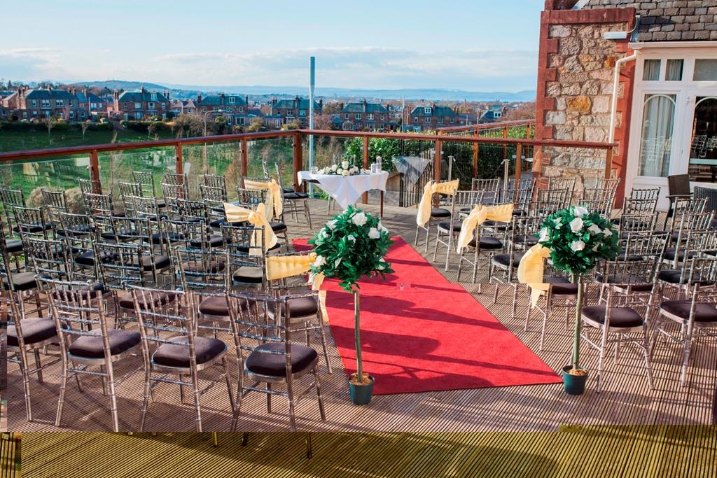 Outdoor wedding ceremony with views of Edinburgh city