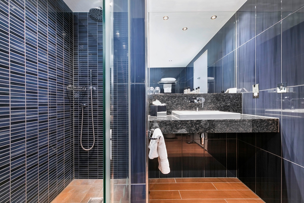 Bathroom with walk in rain head shower
