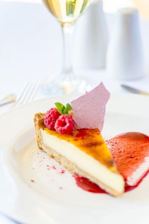 Glazed Lemon Panacotta Tart, Raspberry Gel, Raspberry Meringue, Fresh Mint