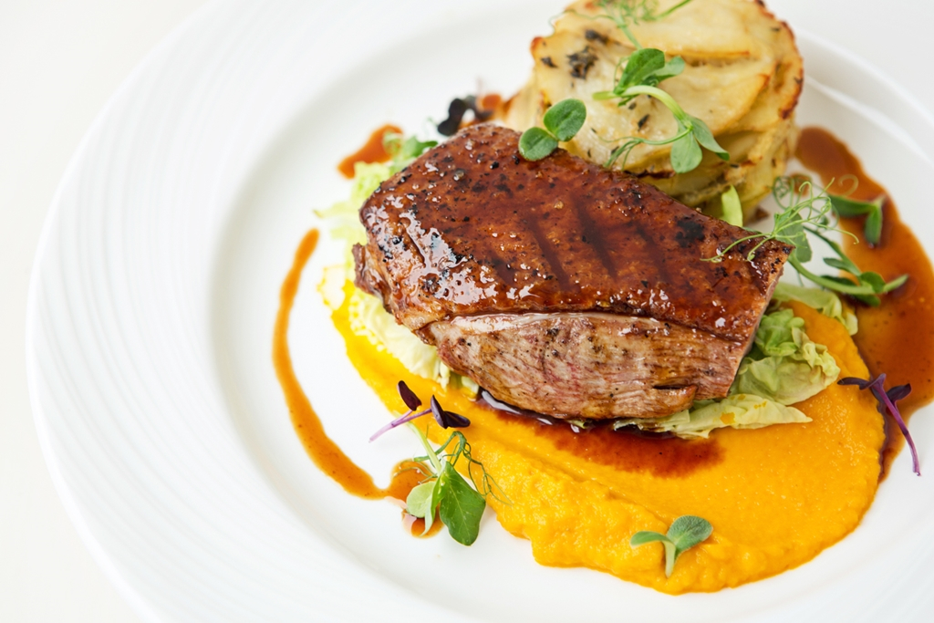 Seared Madgett's farm duck breast Carrot and coriander seed purée, savoy cabbage, Boulangére potato
