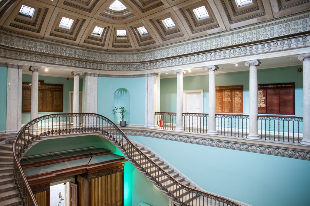 The gallery and suspended staircase in the Great Hall at Leigh Court.
