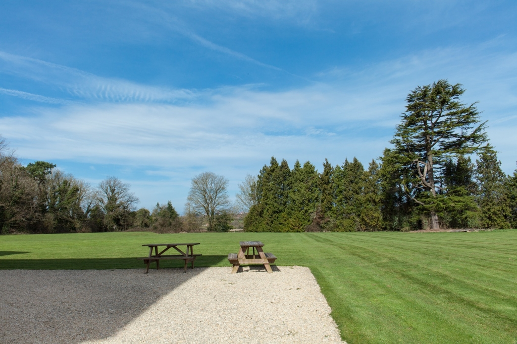 The lawns Leigh Court looking towards the Welsh hills.