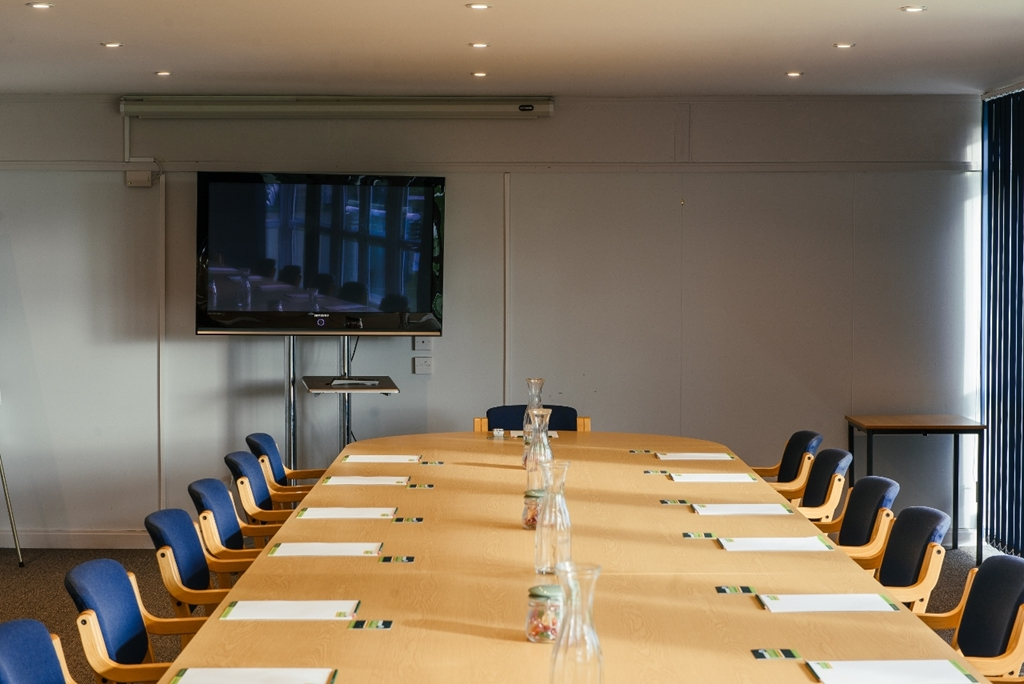 Upper Lindfield Suite boardroom style with plasma screen